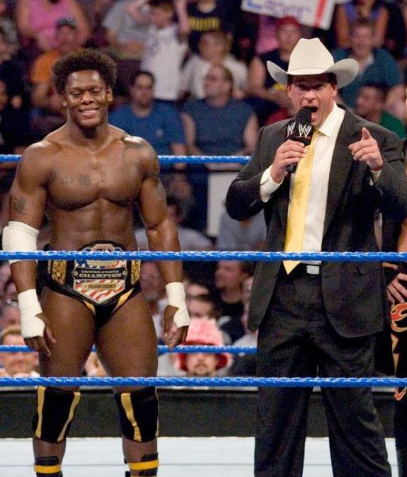 United States Champion Orlando Jordan alongside JBL while part of The Cabinet faction stable in WWE in 2005.