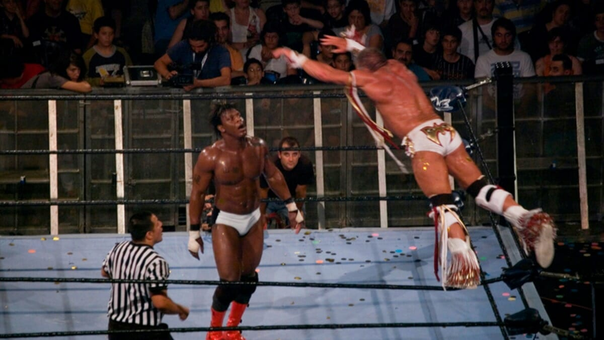 The Ultimate Warrior glides in the air towards his opponent, Orlando Jordan, in what would be Warrior's final-ever match. Nu-Wrestling Evolution, Barcelona, Spain, June 25, 2008.