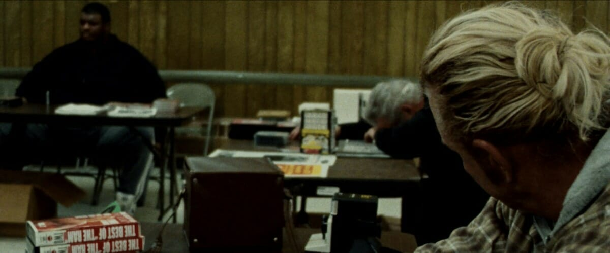 As it turns out, the memorable wrestling convention scene in The Wrestler was filmed at an actual convention. Randy 'The Ram' Robinson, played by Mickey Rourke, looks over towards Manny Yarbrough (left) and Johnny Valiant, who was legitimately taking a snooze at his autograph table during filming.