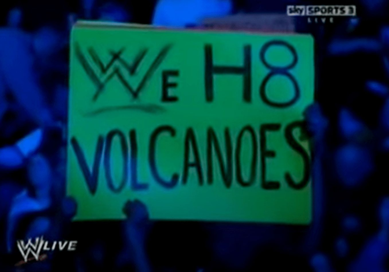 A fan holding up an anti-volcano sign as Triple H addressed the audience. WWE RAW Nightmare!   The Volcanic Eruption That Forced Big Changes