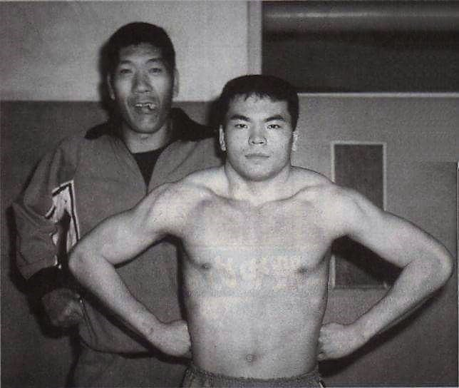 """Mitsuharu Misawa as a trainee with Shoei """"Giant"""" Baba in AJPW circa '81. Baba became Misawa's witness at his wedding as well."""