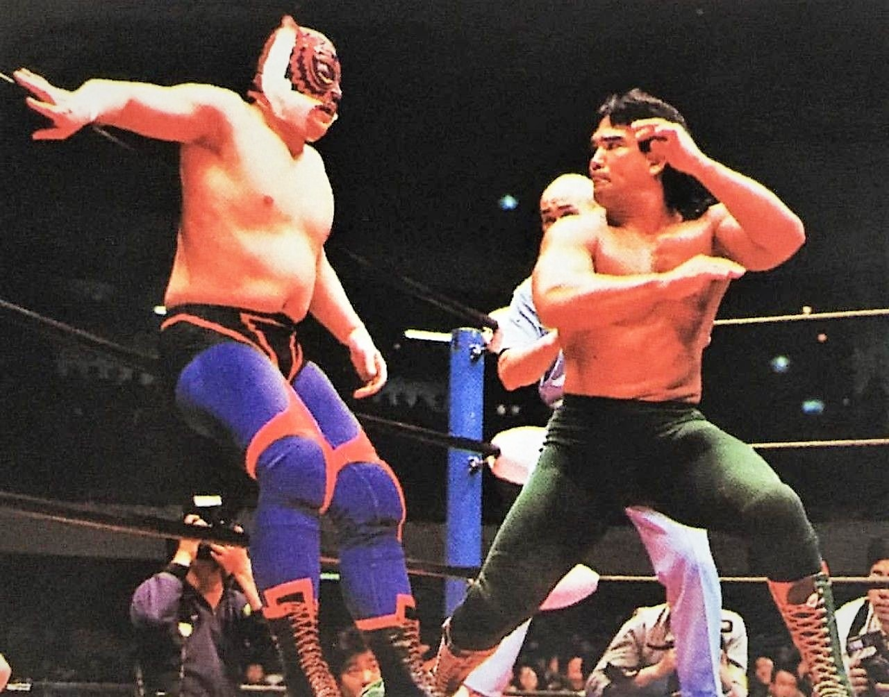 """Wrestling as Tiger Mask II, Mitsuharu Misawa faced top opponents like Ricky """"The Dragon"""" Steamboat in 1989 for the NWA World Heavyweight Title."""