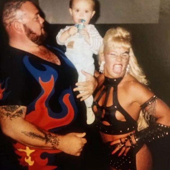Bam Bam Bigelow and Luna Vachon backstage with Sean Waltman's son, Jesse.