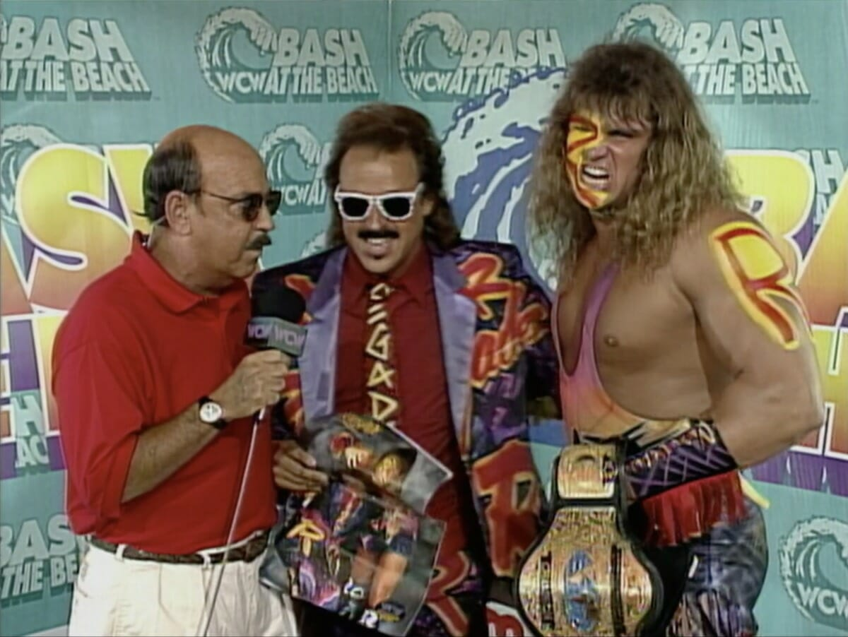 Gene Okerlund, Jimmy Hart, and WCW Television Champion The Renegade at Bash at the Beach 1995.