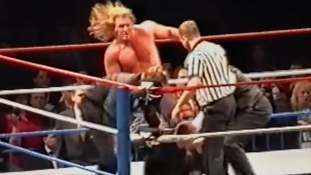 Triple H comes to the aid of Stone Cold Steve Austin after a fan attacked him in Germany.