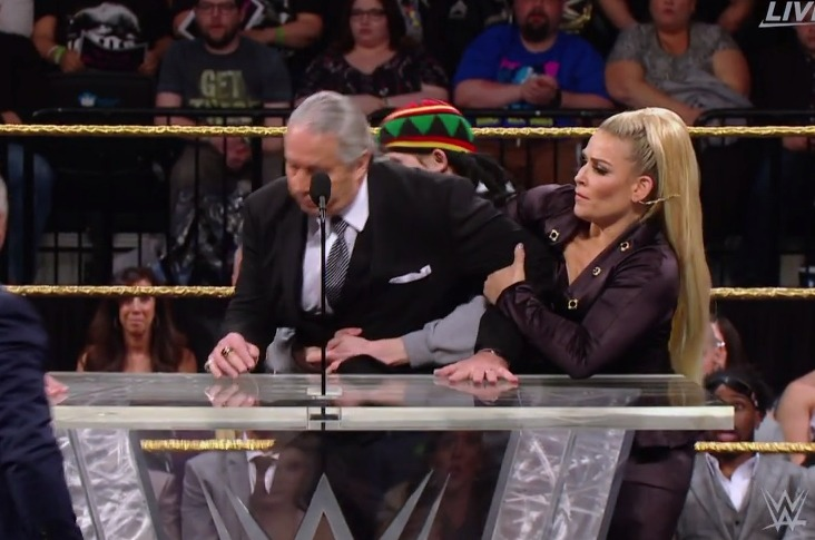 A disrespectful fan tackles Bret Hart at the 2019 WWE Hall of Fame ceremony.