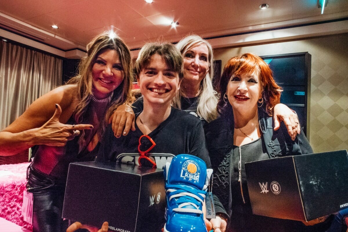 """GLOW originals Hollywood, Roxy Astor, and Eileen """"MTV"""" O'Hara with a happy fan on the AfterGLOW cruise in 2018."""