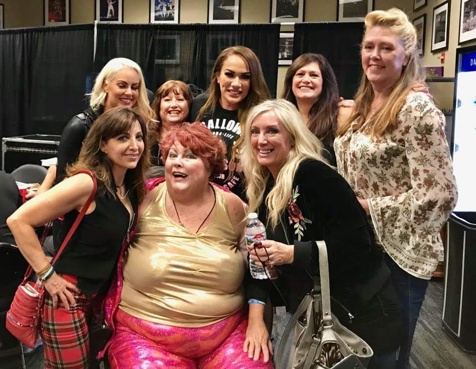 Original GLOW girls meet Nia Jax and Maryse backstage at a WWE event in 2017.
