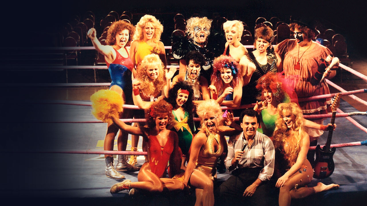 GLOW Director Matt Cimber surrounded by the Gorgeous Ladies of Wrestling.