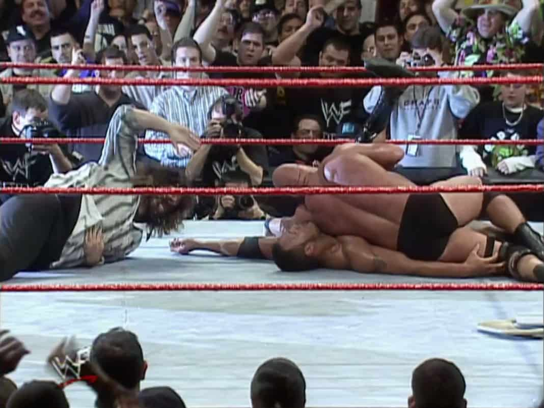 The Rock and Steve Austin at WrestleMania 15, when Austin pins The Rock to the mat.