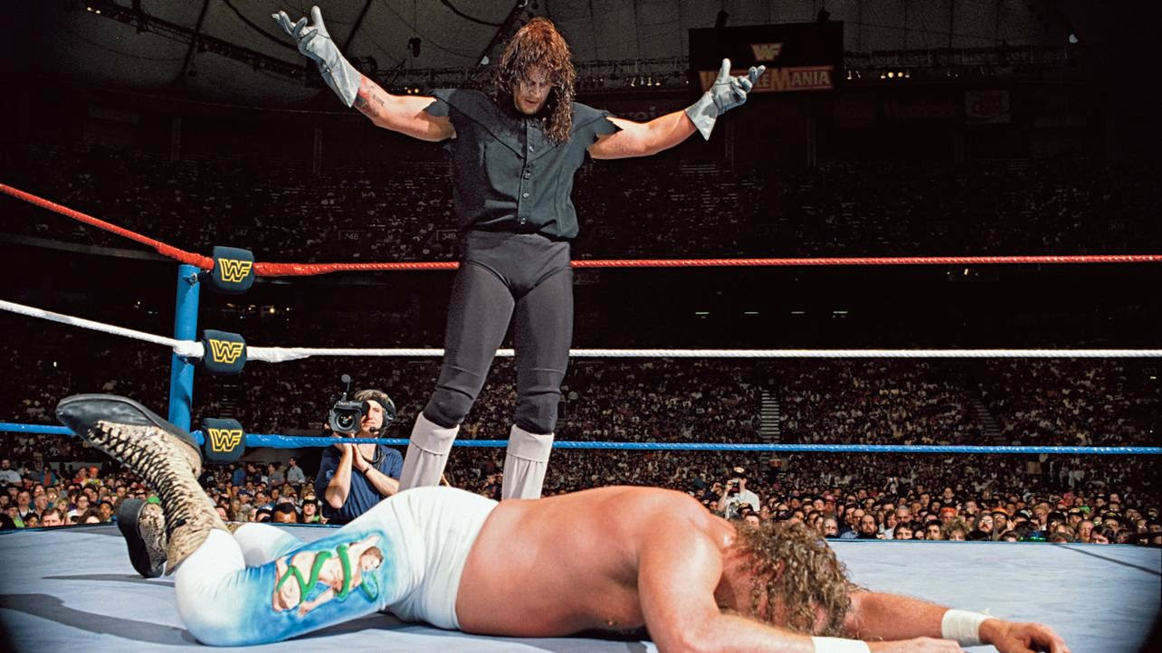 Undertaker stands tall over Jake Roberts at WrestleMania 8.