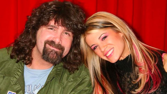 Mick Foley with Ashley Massaro. He and Ashley lived in the same town as one another, and he wishes he could have done more to help her.