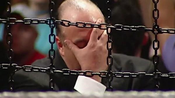 Paul Heyman covers his eyes in disgust at WWE December to Dismember.