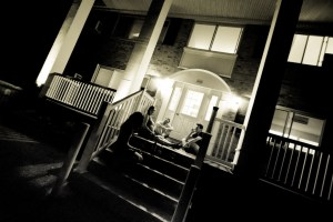 people sit on a stoop and talk at night