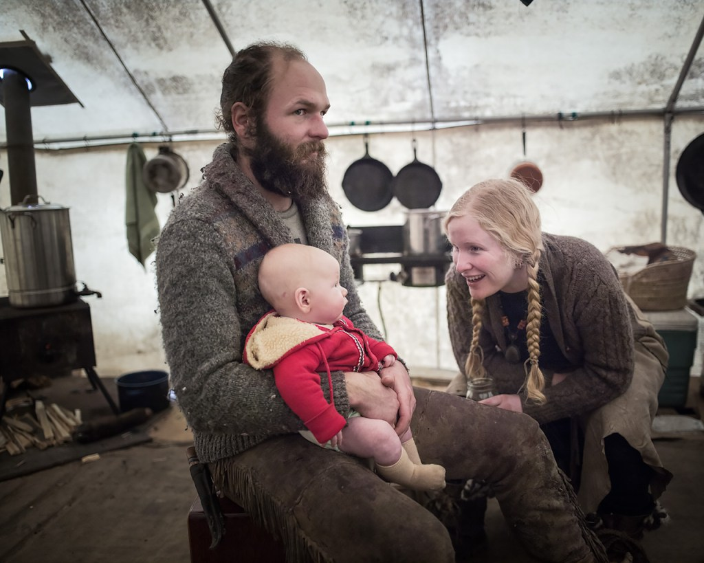 This scavenger couple and their baby boy live in a wall tent during the anual buffalo treaty hunt in Montana.