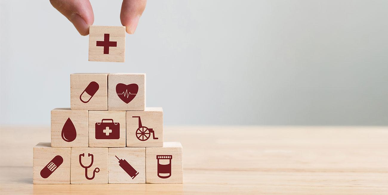 Pirâmide de quadrados com desenhos relacionados com saúde