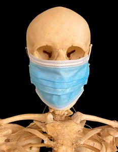 picture of human skeleton wearing a face mask