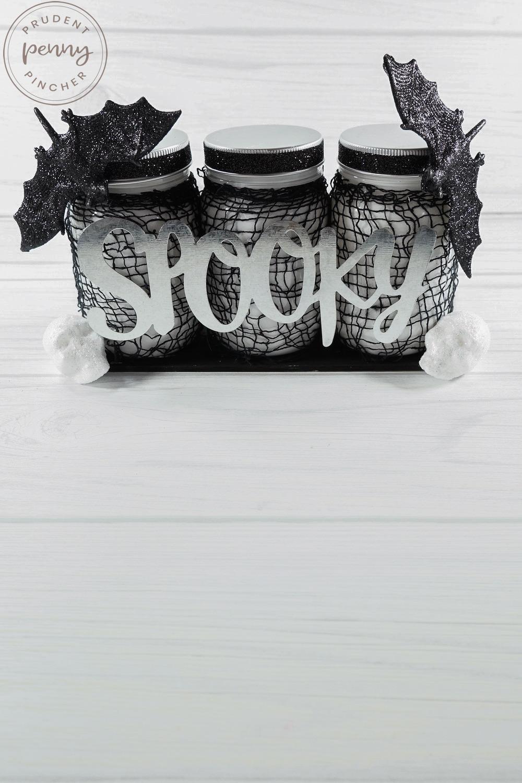 vertical image of mason jar halloween centerpiece