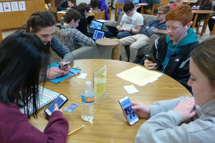 Students in the library check their phones constantly.