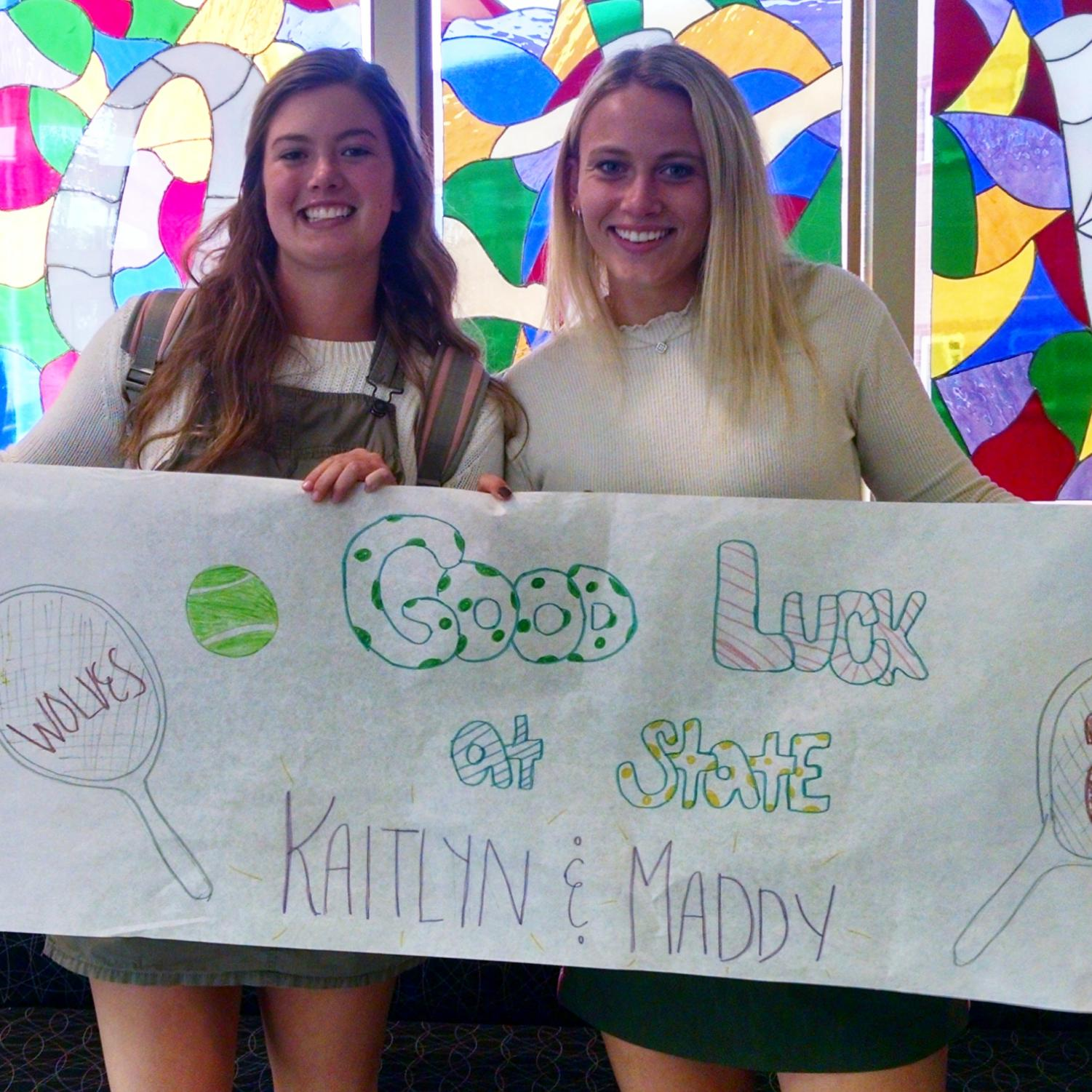 Tennis players Kaitlyn Theil and Maddy Ljunggren pose for a picture after the state send-off parade this afternoon.