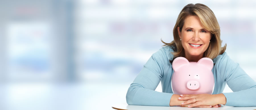 relationship-to-money-women-with-pink-piggybank