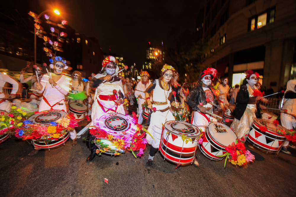 Halloween History - West Village Halloween parade filled Sixth Avenue with vividly costumed participants while thousands more watched from the sidelines