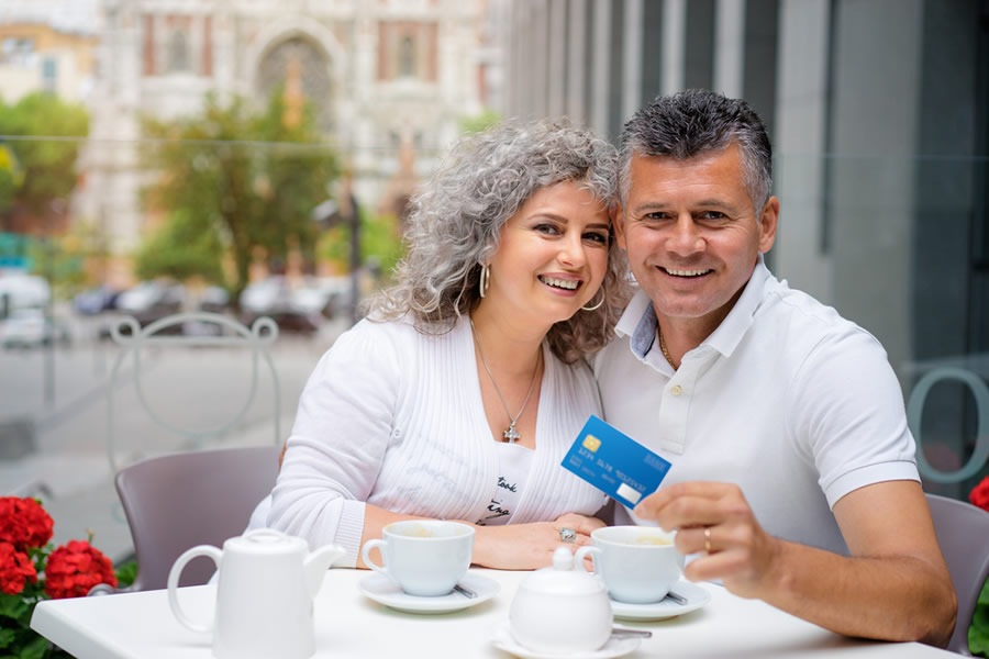 Dating Money - mature-couple-dating-and-paying-for-meal-at-restaurant