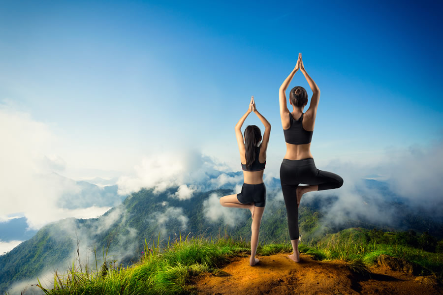 Money Lessons - mother-and-daughter-doing-yoga