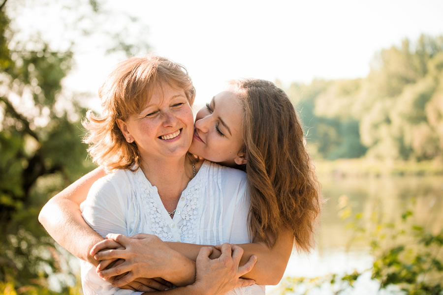 Money Lessons - daughter-hugging-mother