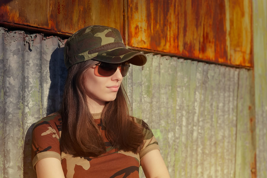 Grit - military-female-veteran-leaning-on-wall