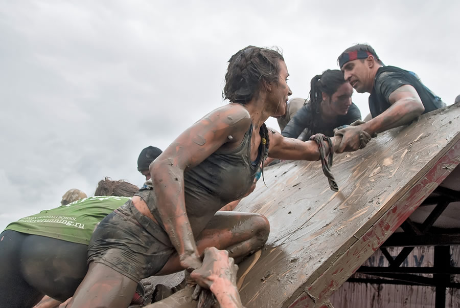 Grit - muddy-women-climbing-wall