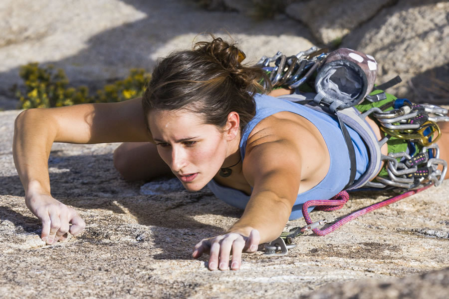 Grit - woman-climbing-cliff-face