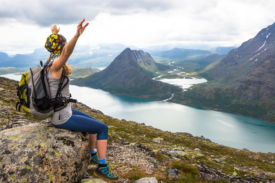 Grit - woman-on-mountain-top