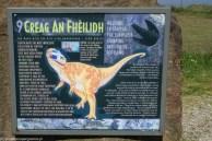 tablica z podobizną dinozaura