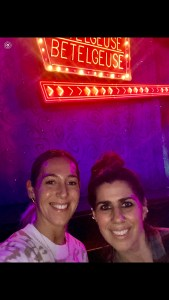 Ms. Molier and Ms. Durante in front of Betelgeuse sign