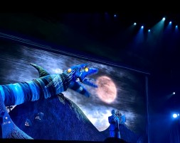 Stage backdrop: An oversized Beetlejuice hand reaching for the moon