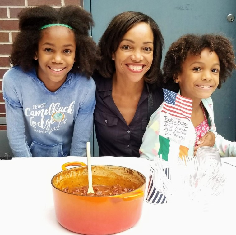Mom and her two daughters posing with baked beans