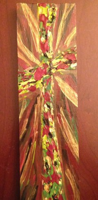 Radiant Red and greens and gold wood cross