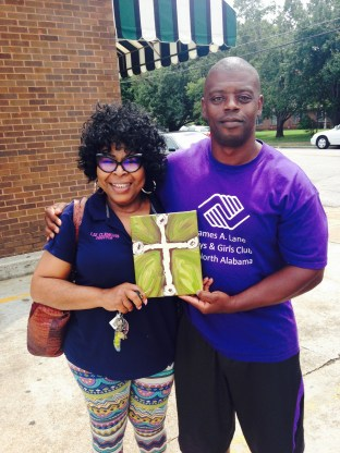 My friends Calvin and Liz-adding a cross to the James A. Lane Boys and Girls Club Teen room!