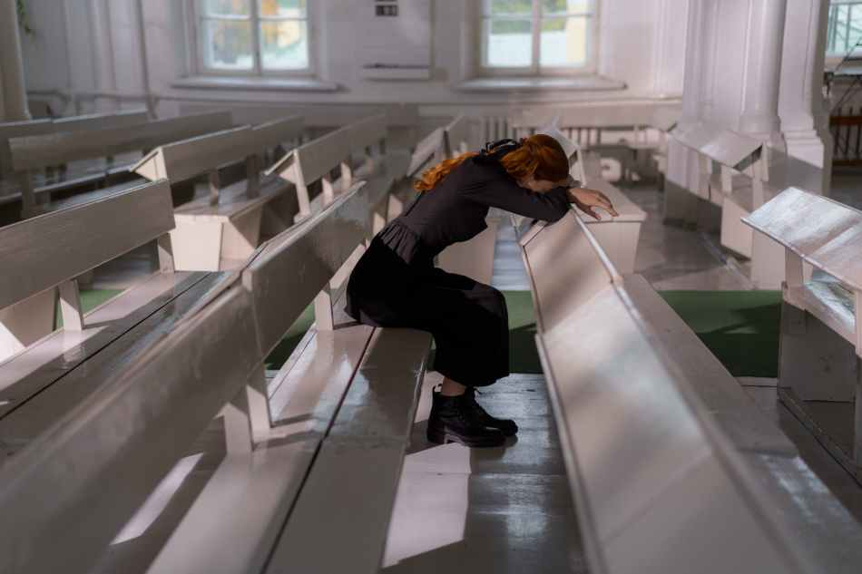 woman in black jacket and black pants sitting on white staircase