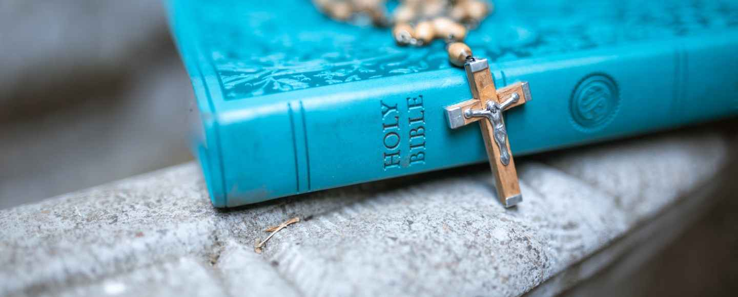 rosary on holy bible