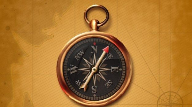compass with black center and golden edge on a old map