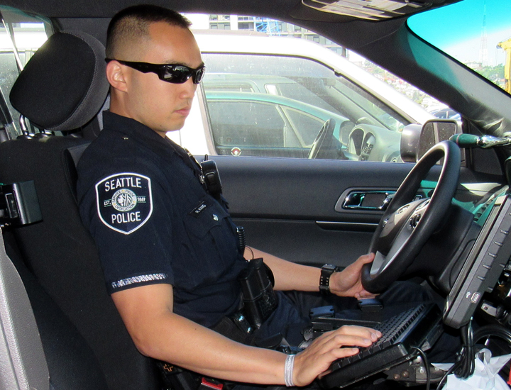 Police officer in car using radio