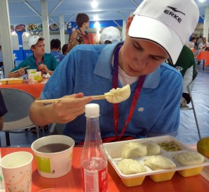 Jason Bredehoeft eats his first meal as a volunteer for the China Open.