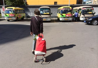 The grocery store has buses (against the wall) and free rides for its patrons.