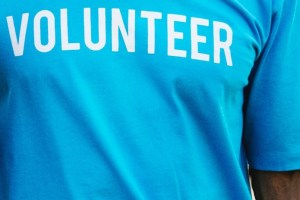 blue background with word volunteer