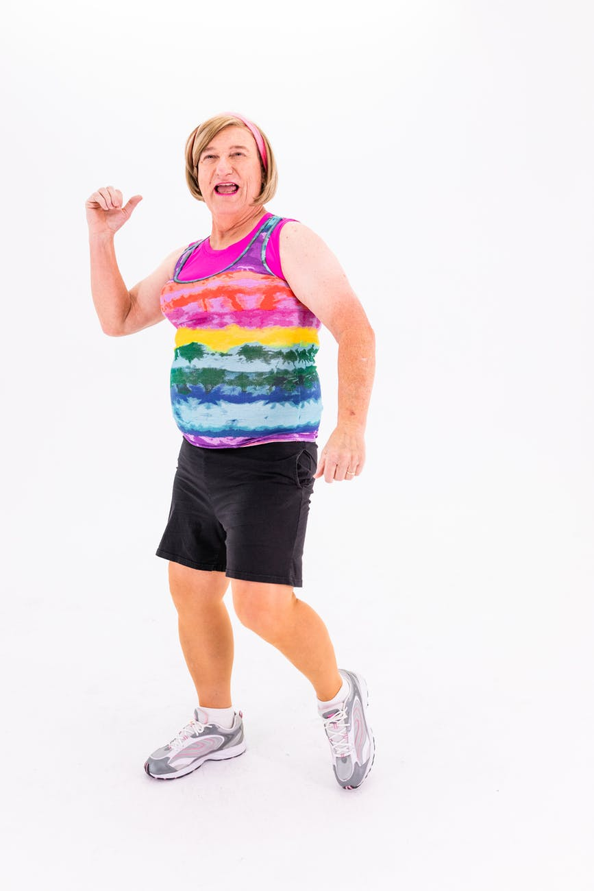 elderly woman in black shorts and colorful sleveless shirt