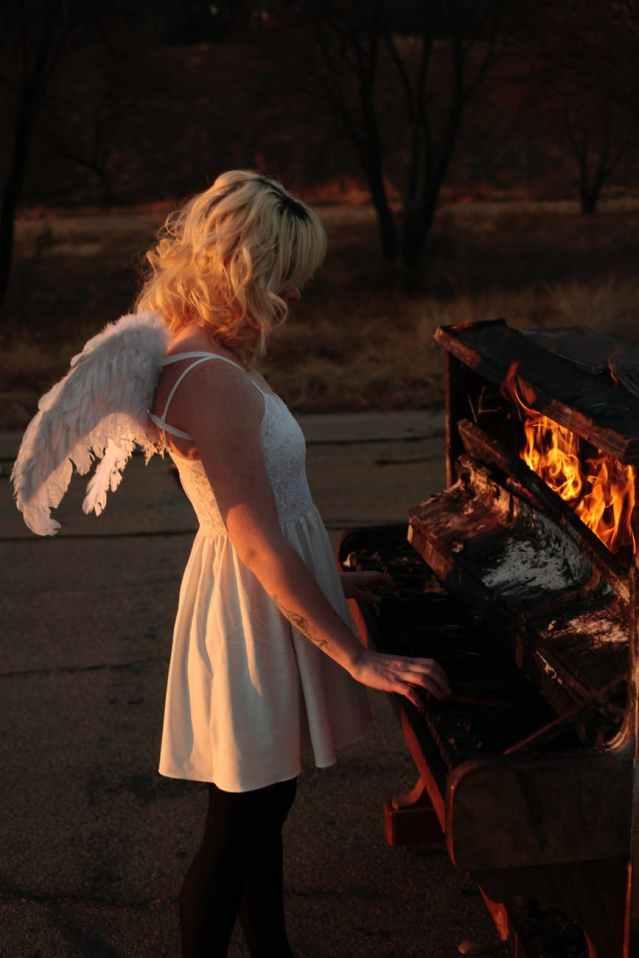 woman playing on burning piano