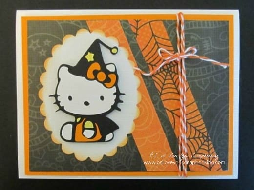 Hello Kitty Halloween Card - These handmade Halloween Cards, Invitations, and Treat Bags use a variety of materials from buttons to the Cricut. With just a few supplies, you can create fun Halloween paper crafting projects too.