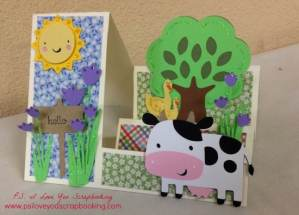 Stair Step Card that fits into and A2 size envelope decorated with patterned paper and Cricut die cuts.